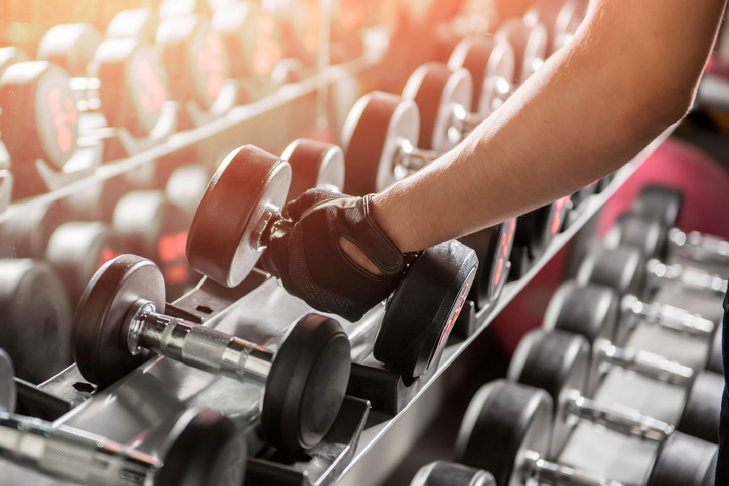 Hand Reaching For Weights In The Gym