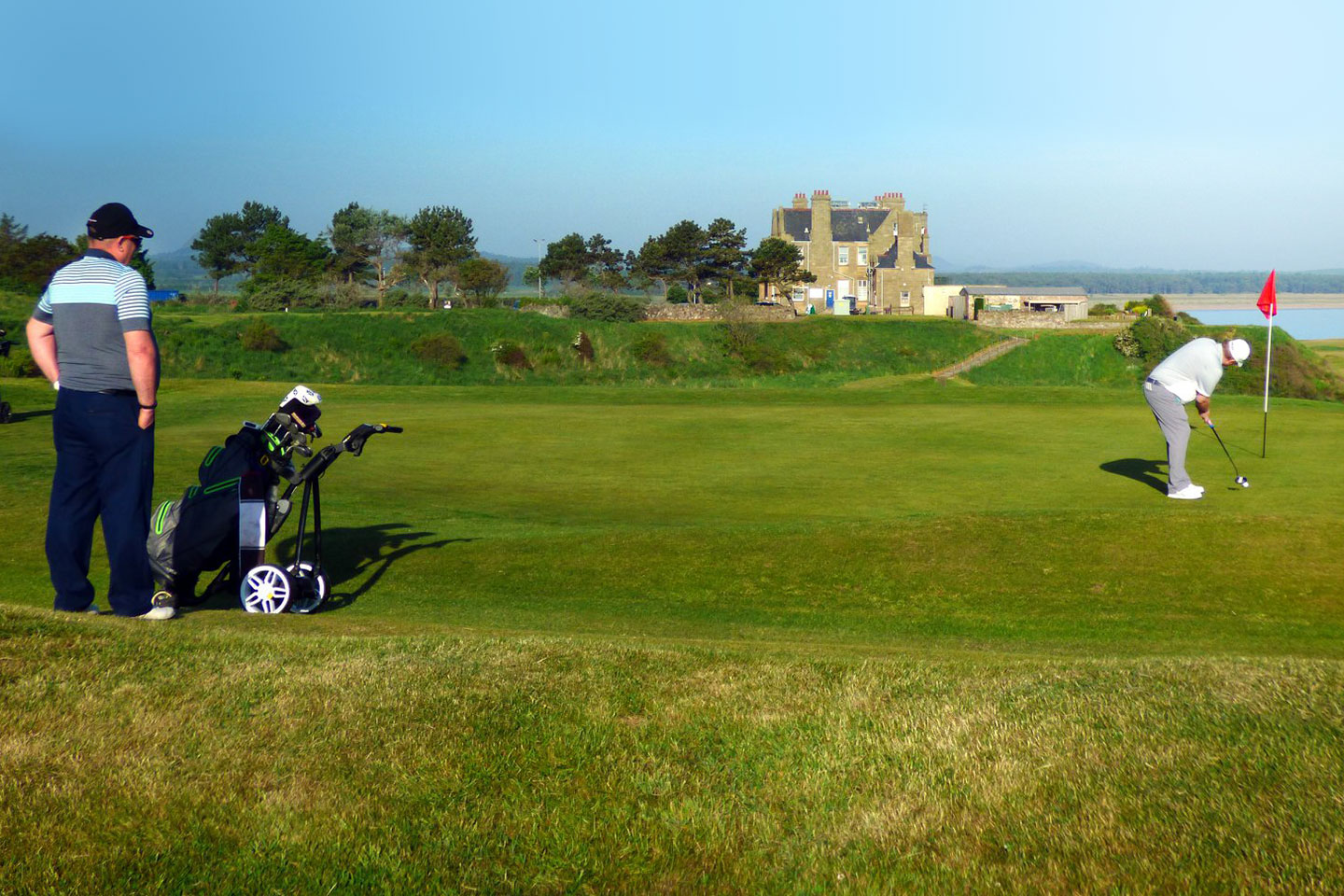2 Men Playing Golf At St. Margret's Golf Course
